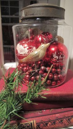 Vintage Christmas Ornaments & Garland...old glass jar. Mom had a jar very similar to this one.  You could tell the glass was  old because of the bubbles in it, and the top was hand crafted tin
