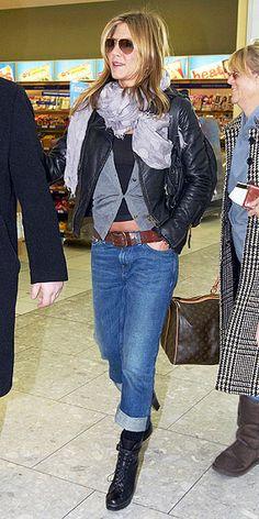Jennifer Aniston - black tank top, grey sweater, leather jacket, shawl, jeans, brown belt, black army style boots