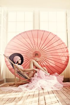 jazz age bathing beauty fashion pink umbrella trend swimsuit