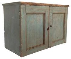 Early century New England Hanging Cupboard with original blue paint. Dovetailed case with two paneled doors, and applied molding at the top. the interior of the cupboard is naturial patina wide x deep x 16 tall Primitive Furniture, Primitive Antiques, Country Furniture, Wall Cupboards, Cabinets, Blue Matter, Country Treasures, Braided Rugs, Door Wall