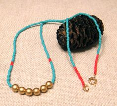 Necklace with gold, turquoise, and red