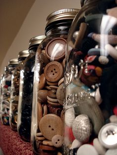 When I have an awesome office/craft room, I will store my buttons in jars where they can be seen.  >:-)