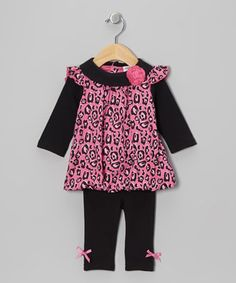 Boasting a pretty flower, wild print and bitty bows, this sweet set will have cuties ready to twirl. Thanks to snaps in back of the bubble-hemmed  tunic and an elastic waistband on the leggings, slipping in is easy.