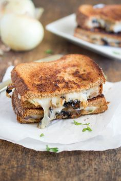 French Onion Grilled Cheese. All of the flavors of French Onion soup you love stuffed into a grilled cheese sandwich. Made with caramelized onions, Swiss cheese, and parsley. | chefsavvy.com #recipe #sandwich