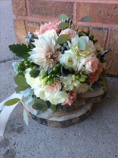 Soft and elegant bridal bouquet of roses, dahlias and ranunculus!