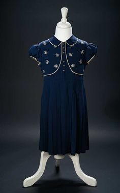 "Love, Shirley Temple, Collector's Book: Lot # 460: Navy Blue Silk Dress Worn by Shirley Temple in the 1938 Film ""Just Around the Corner"""