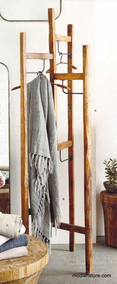 The Recycled Teak Display stand by Roost. Flexible retail store display piece or a stylish coat rack. Three arms, with curved iron hanger bars. hat. coats vintage look
