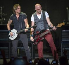 Country music singer Keith Urban performed with bassist Jerry Flowers at Klipsch Music Center Saturday, August 24, 2013. Two opening acts - Dustin Lynch and Little Big Town - got the evening of music started for the huge crowd. / Doug McSchooler/for The Star