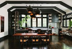 A kitchen in need of an update will look like it got a full-on facelift if the cabinets are covered in a new coat of black paint, plus the shade will complement essentially all existing wall colors.