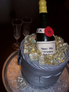 This is a Champagne Birthday chocolate cake. The ice cubes are made of sugar and corn syrup and the bottle is made of chocolate.