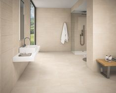 These oblong glazed porcelain tiles are in 2 relaxing stone colours adding a stunning full wall feature to your new bathroom project or accent to your kitchen. You can use the plain version for a coordinating floor without any worries on marking or staining - as its a glazed porcelain tile it is both strong and totally maintenance free. #decor #diy #walldecor #stonefloor #bathroomfloor #bathroomwall #kitchenwall #kitchenfloor #wetroom #walltile #floortile #stone #stoneeffect #stonetile Bathroom Flooring, Kitchen Flooring, Bathroom Wall, Mosaic Tiles, Wall Tiles, Porcelain Tiles, Wet Rooms, Stone Flooring, Stone Tiles