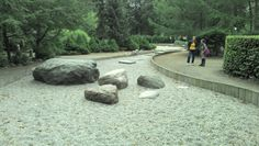 Textured play surface with boulders.