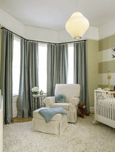 A San Francisco, Noe Valley nursery with a bay window facing the street uses a custom curtains to solve light and sound problems with blackout and noise reduction features while remaining stylish and functional.