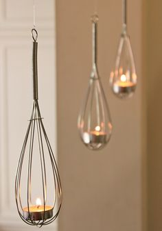 Tealights in hung whisks. Sweet idea.