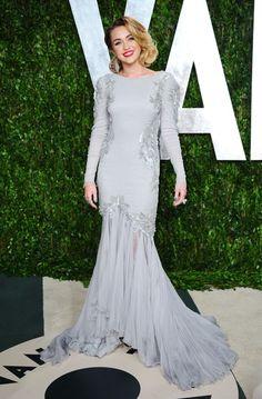 Miley Cirus in a Roberto Cavalli dress.