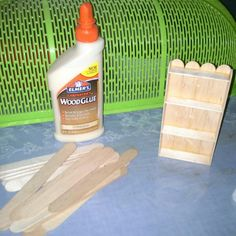 Popsicle sticks + wood glue = mini bookshelf, not a tutorial but the picture shows how.