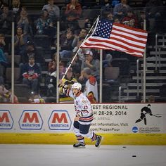 Feb. 2nd 2014 - Johnny Laursen, a member of the 2013-14 USA Warrior Ice Hockey Team (DAV Partner), carries the American flag during military appreciation night at a Cincinnati Cyclones home game. As a wounded veteran Johnny joins the team from the United States Army: Fort Drum - 10th Mountain Division.  #veterans #sot #hockey #love #respect #woundedwarrior #disability #ability #nevergiveup
