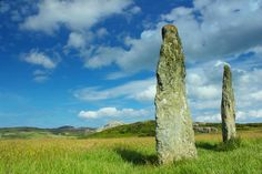 Penrhos Feilw Standing Stones Holy Island, Anglesey, North Wales. These Bronze age stones are set against the backdrop of Holyhead Mountain. They are 3m high and are set roughly the same distance apart.