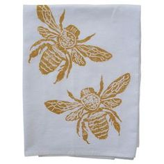 """Showcasing a bee motif in gold, this hand block printed cotton dishtowel lends a touch of charm to your kitchen decor.  Product: Set of 2 dishtowelsConstruction Material: 100% CottonColor: GoldFeatures: Hand block printedDimensions: 30"""" x 30"""""""