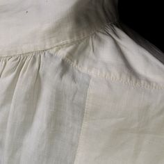 This image shows the shoulder from the inside. The seams are just as neatly finished inside as out. Shoulder seams interior, WRHS 61.82.8 See more detail by clicking on the image!