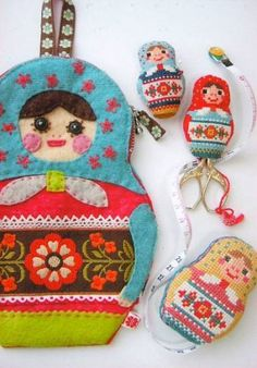 Top 100 craft tutorials of 2010 by The Long Thread. The matryoshka doll cross stitch, plus others, can be found at Superbuzzy. Cross Stitch Designs, Cross Stitch Patterns, Felt Crafts, Fabric Crafts, Matryoshka Doll, Japanese Fabric, Felt Dolls, Felt Ornaments, Cross Stitch Embroidery