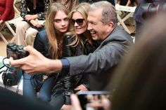 BURBERRY SPRING/SUMMER 2015 WOMENSWEAR SHOW BACKSTAGE AND FRONT ROW / Guests includes British models Cara Delevingne, Kate Moss and the famous fashion photographer Mario Testino who just turned sixty.