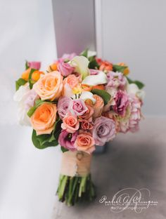 Pink Coral Wedding bouquet accented with a touch of mauve. Flowers by Rachel A. Clingen.