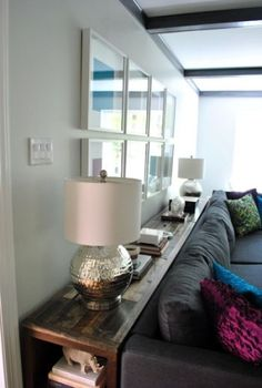 I think i pinned a similar one, but i like the idea of shelves on the ends better. Long Table/Storage behind a couch