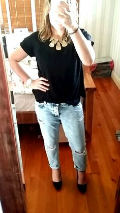 It's a casual kinda eve..... boyf jeans, black tee, statement necklace and heels