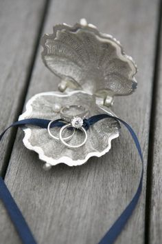Silver and pearl clam ring holder for a beach wedding. BHLDN. Photography by samanthamelanson.com