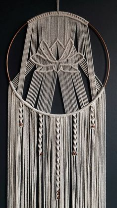 Handmade contemporary cotton macrame dreamcatcher, with lotus flower detail. Made on a copper hoop with copper bead details. Hoop: 22.5cm diameter Length of piece: 100cm Made to order and open to commissions of an alternative design to the lotus. Message me with your ideas! Dip dyed / other colour options available. Just ask! Thanks for looking! Janie