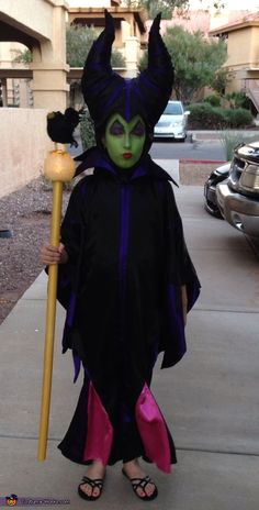 8 Year old Jaquelynn as Maleficent this year she wanted to be a villain she picked Maleficent. Her costume is handmade, the headpiece is made of fabric and her staff was made from a dowl and LED floating orb that I replaced the LED light. Funny Group Halloween Costumes, Best Couples Costumes, Homemade Halloween Costumes, Theme Halloween, Halloween Costume Contest, Costumes For Teens, Halloween Costumes For Girls, Diy Halloween, Costume Ideas