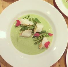Chilled mint, pea and coconut soup topped with lobster, sugar snap ...