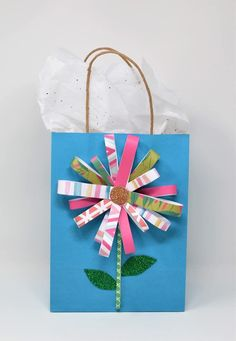DIY flower gift bag - gift bag upgrade - DIY gift bag - gift giving flowers quotes Spring Wreath Idea with AC Moore Birthday Gift Bags, Homemade Birthday Cards, Diy Baby Gifts, Diy Mothers Day Gifts, Homemade Gift Bags, Decorated Gift Bags, Diy Spring Wreath, Browns Gifts, Easy Paper Crafts