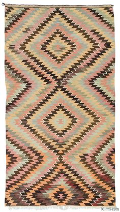 Vintage Turkish tribal kilim rug handwoven in mid-century in the Mut region of the Taurus Mountains by the Taurus Yoruks who are migratory people of Central Asian origin. This kilim is in very good condition.