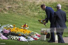 Britain's Prince William, Duke of Cambridge, lays flowers at the 7/7 memorial in London's Hyde Park on July 7, 2015, in memory of the 52 people killed during the 7/7 London bombings of 2005. Britain today marked 10 years since the London bombings with a minute's silence for the 52 victims, less than a fortnight after an attack in Tunisia highlighted the ongoing Islamist threat.   AFP PHOTO / JACK TAYLOR        (Photo credit should read JACK TAYLOR/AFP/Getty Images)