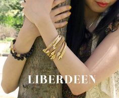 Stack up on romantic gold bracelets from Liberdeen.