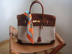 Hermes...*LOVE*...call me a Hermes gal (for real..)...Love this bag & scarf..and Pippa stool...I have a vintage director's chair that would look great with this~~