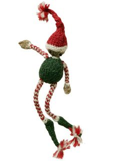 This cheerful holiday elf is sure to put a smile on your face! He looks very festive long with candy striped arms and legs and pointy shoes! The jaunty pom poms adorn the tips of his shoes and the top of his Santa hat. Just the right size for a Christmas ornament or a gift decoration.