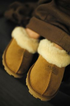 The women's Coquette slipper from UGG® Australia boasts the divine feel of a comfortable #slipper with indoor/outdoor function and features ultra-soft sheepskin in stylishly feminine silhouette.