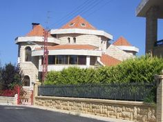 Newly renovated Lebanese house built from traditional lime stone, with red tiled roof and arches