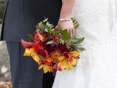 Stunning oranges, reds and yellows in this bouquet from Mark Bryan Designs!