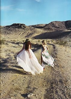 Love the softness of the photo. The juxtaposition between the plain dirt setting and the lovely soft dresses create an alluring and beautiful photo. Perfecto!