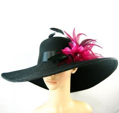 Black hat with fuchsia flowers