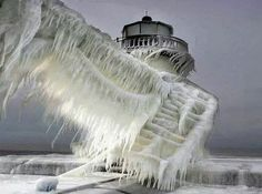 A frozen lighthouse near Lake Michigan. - The 30 Most Amazing Photos Of Frozen Things In Honor Of The Coldest Morning Of The 21st Century