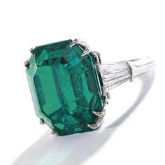 Harry Winston 16.35 carat Emerald ring, with tapered baguette cut diamonds, c. 1955, Sotheby's