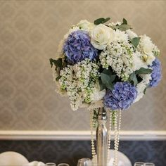 This gorgeous blue & white arrangement by Add Style delicately displays winter beauty. Wedding Flowers - White, Blue, Centrepiece, Decorations, Idea