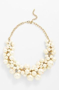 Add elegance to your prom style with a faux pearl bib necklace.