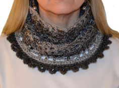 A beautiful spider web cowl crocheted in tones of gray to keep you warm as the weather turns cooler this fall.  #cowl #scarf #spiderweb #spider #gray #women #accessories #mountainmajik