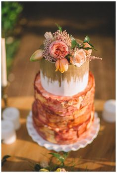 Wedding cake with gold and rose gold details by Love Is In The Air. Image by Sam Stroud Photography.